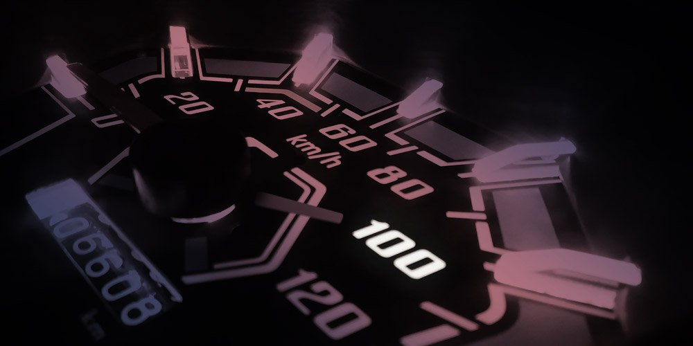 Speedometer pointing to 100 mph