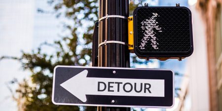 "Traffic sign says ""Detour""."