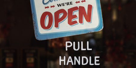 Open sign with pull handle on door